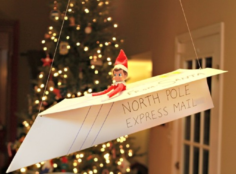 elf arriving by paper plane air mail