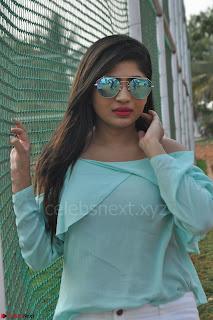 Madhulagna Das looks super cute in White Shorts and Transparent Top 05.JPG