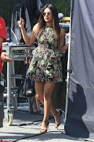 Priyanka Chopra looks super cute in happy mood wearing a short flower print dress in Hollywood 016.jpg