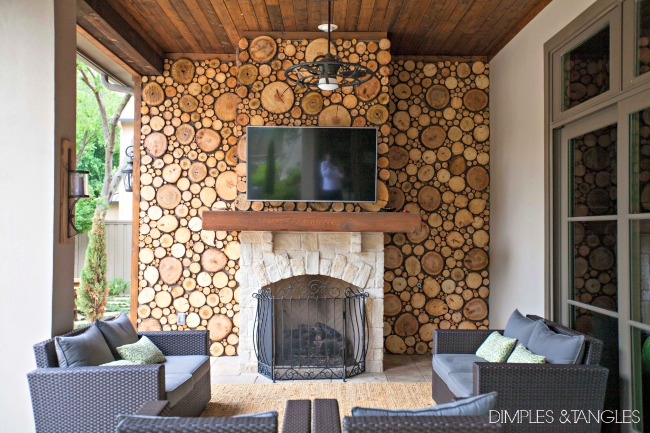 patio, outdoor space, outdoor living area, wood slice wall, wood disc wall, outdoor fireplace