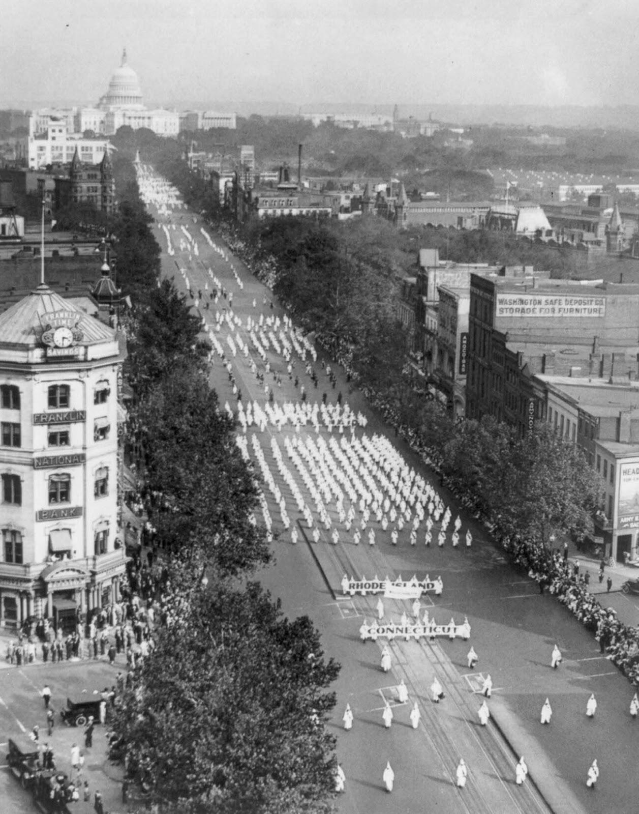 Klan members parade down Pennsylvania Avenue.