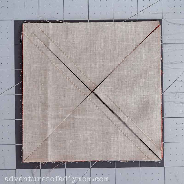 cutting the sewn squares of fabric