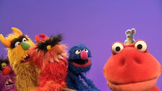 Grover, Frazzle and some monsters are trying to pull a rope. mouse, dinosaur, Sesame Street Episode 4419 Judy and the Beast season 44