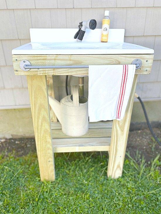Outdoor sink with towel rack and grain sack towel