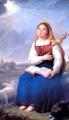 Foto de Santa Genoveva sentada con su libro
