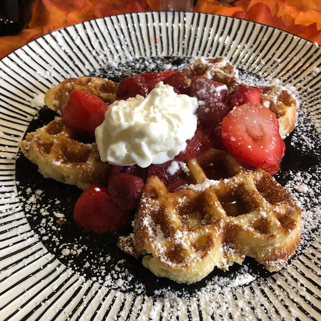Delightful fresh Belgian waffles topped with syrup, berries, whipped cream and powdered sugar at Guardian Angel Bed and Breakfast. Yum!