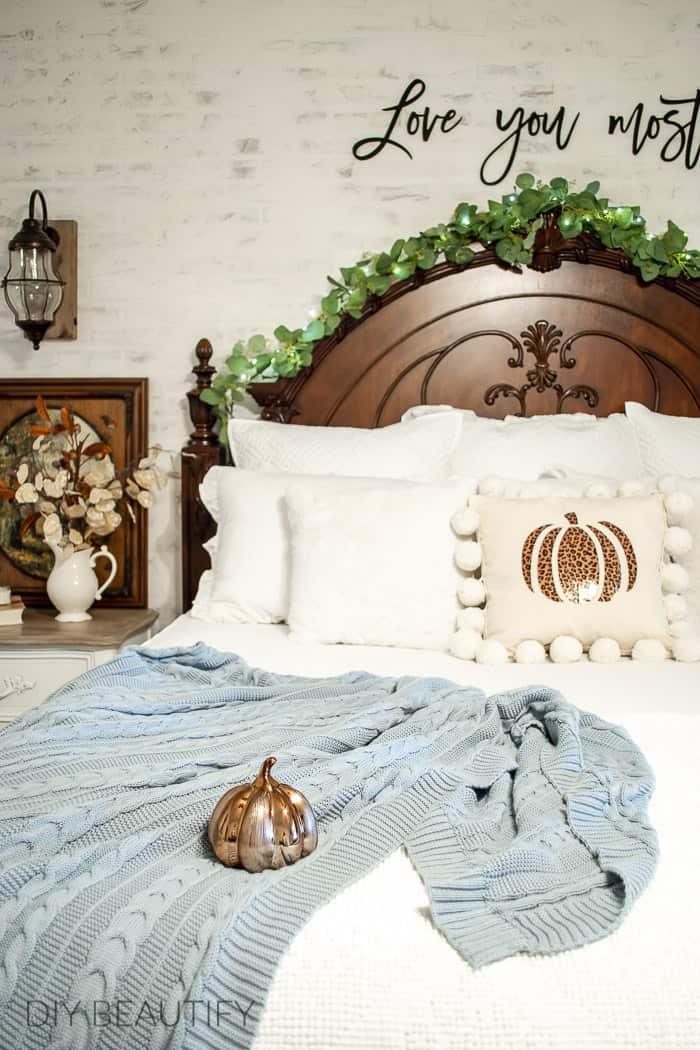 copper pumpkin on sumptuous bedding