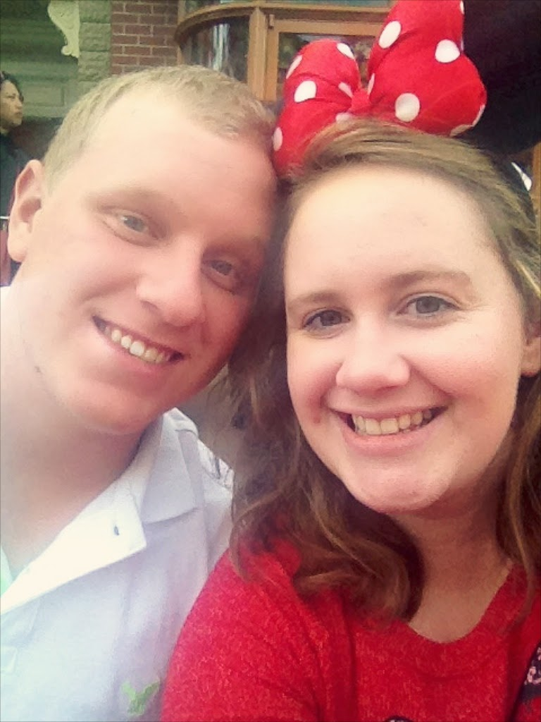 couple wearing minnie mouse ears