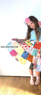 A girl showing off her fun patchwork dress