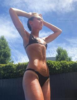 fashion- designer, makeup- artist- Mia- Sporting- tiny- black- bikini