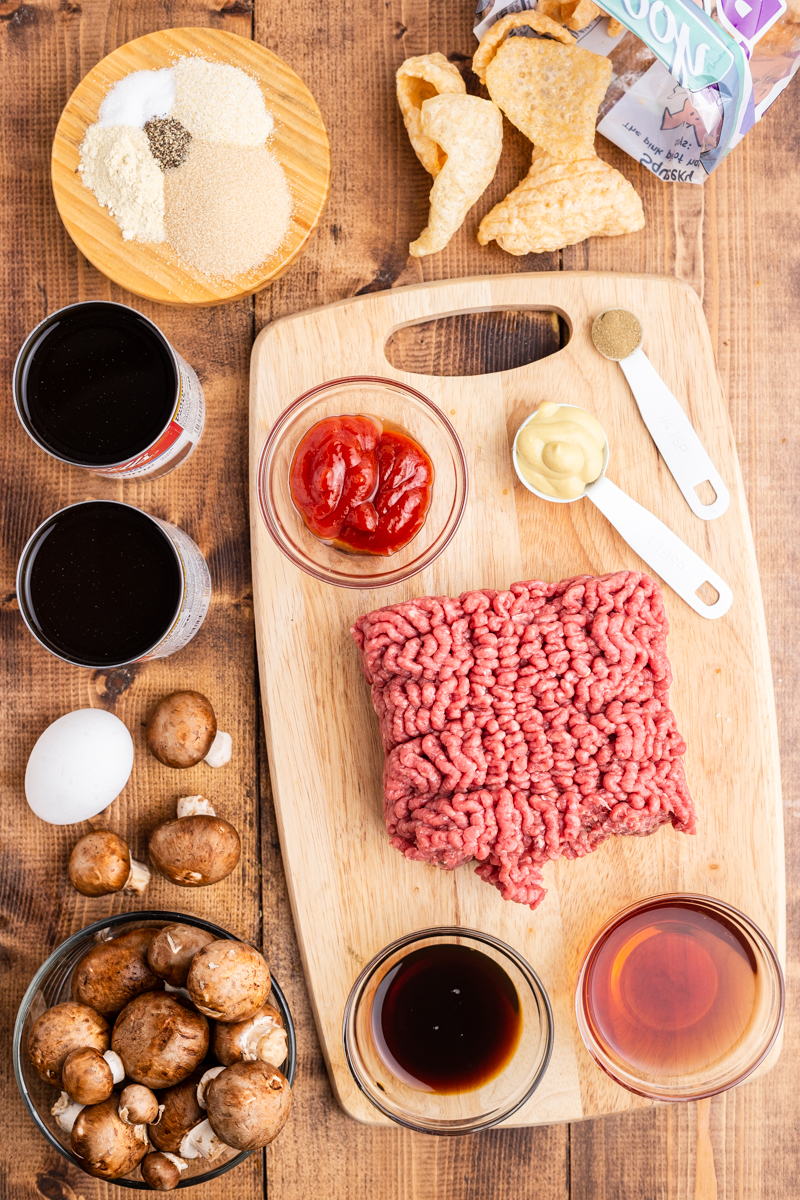 Overhead photo of the ingredients needed to make Keto Salisbury Steaks with Mushroom Gravy on a wooden table.