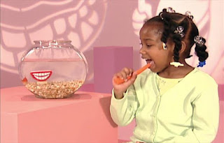 A girl explains that she eats crunchy vegetables to help care for her teeth. She eats a carrot. Sesame Street Elmo's World Teeth Kids and Baby