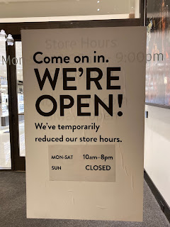 Store hours sign at entrance