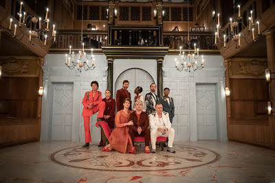 photo of a group of  9 people on stage at the Sam Wanamaker theatre