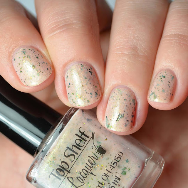 beige nail polish with color shifting flakies