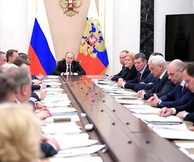 Vladimir Putin and Russian Government members at Kremlin.