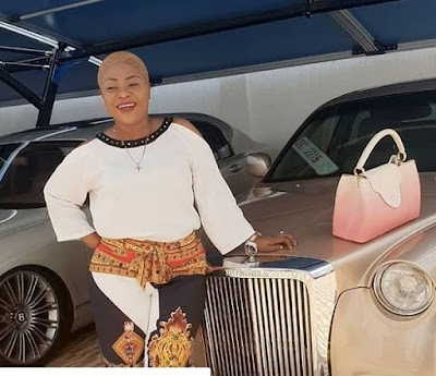 Ghanaians Go Crazy At Rev. Obofour's Wife Cute Short Blonde Hair In New Photo  The wife if the popular controversial pastor, Rev. Obofour has been sighted by tellghana.news in a new photo looking different in appearance.  The mother of Anointed Palace Chapel (APC) has trimmed her lengthy hair short and goes blonde which has course stir on social media attracting a lot of comments.  In the photo, Ciara is seen rocking in a white shirt with a matching black and white trousers standing in front of one of his husband's (Rev. Obofour) luxurious cars with her pick bag resting on the bonnet of the car.