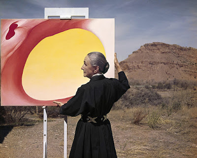 Tony Caccaro Photograph of Georgia O'Keeffe holding Pelvis Red-Yellow painting