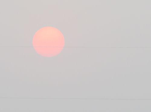 red sun in fog