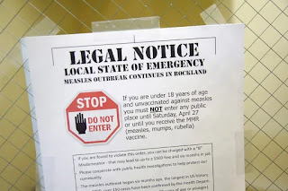 A sign explains the local state of emergency because of a measles outbreak at the Rockland County Health Department in Pomona, N.Y., in March. (Seth Wenig/AP)