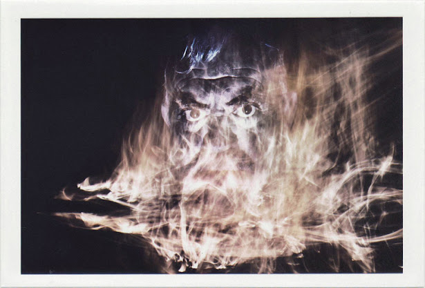 dirty photos - a - dark double exposure photo of man and fire