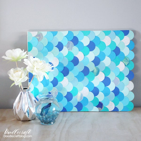 Mermaid scales are iridescent, shimmery and beautiful! Mermaids, fish and nautical themes are perfect for home decor or parties. You can make your own gorgeous piece of art easily.