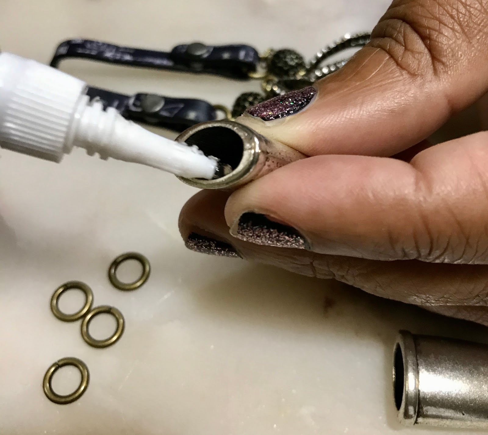 Image: Tangie Bell adding glue to end cap so earring pieces can stick together