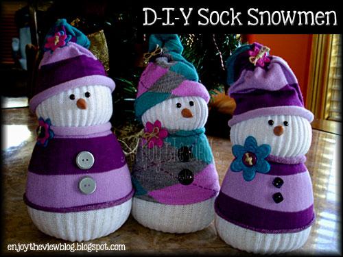 three sock snowmen sitting on  table