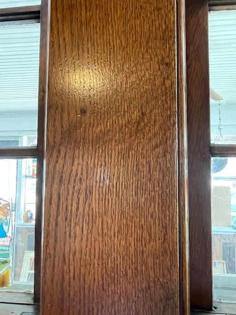 closeup of oak grain on window trim of Grafton Illinois coffee antiques shop Lightkeepers Coffee 101 E Main St Sears Vallonia