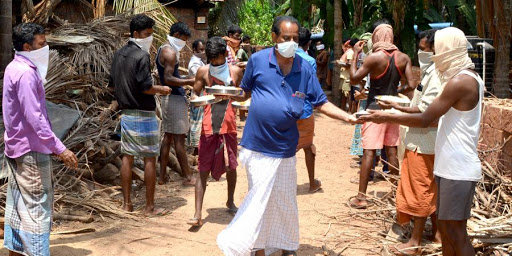 kerala man helping migrants
