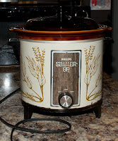 An old slow-cooker pot, one of the first from Philips.