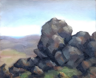 Landscape oil painting of a basalt outcrop with distant rolling hills.