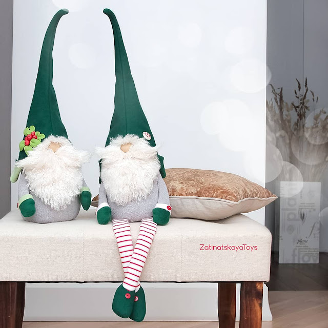two sitting Christmas gnomes on a padded stool by sewing patterns of Zatinatskaya Natalia