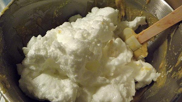cloud of eggwhites over yolk mixture