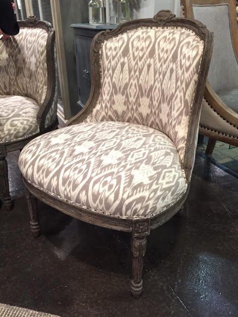 Small chairs with carved details and ikat fabric