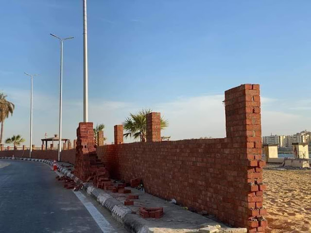 بالصور : بناء جدار بكورنيش سوهاج يثير موجة من إستياء  المواطنين