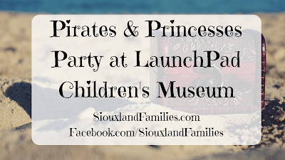 "in background, a dark burgundy leather treasure chest sits on a yellow sandy beach. In foreground the words""Pirates and Princesses Party at LaunchPad Children's Museum"""