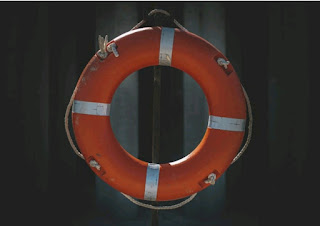 Picture of a red and white water ring floater