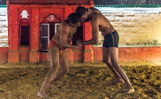 Wrestlers bout it out in an Akhada at Varanasi