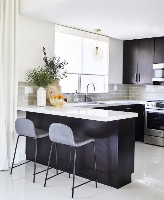 black-kitchen-cabinets-with-white-quartz-countertops