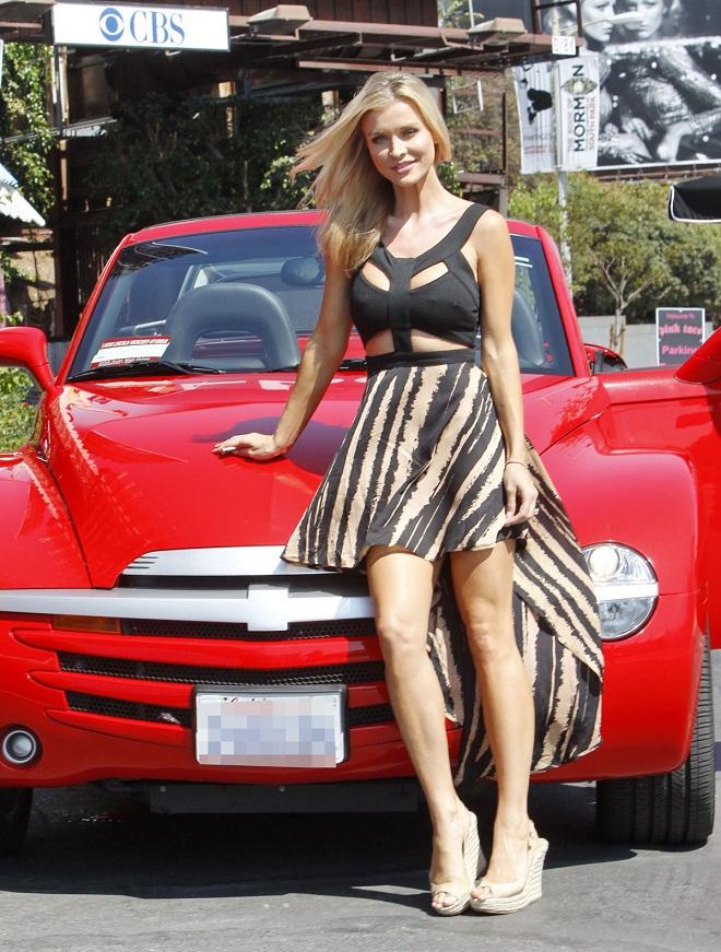 Joanna Krupa in a bondage inspired dress at Pink Taco in LA