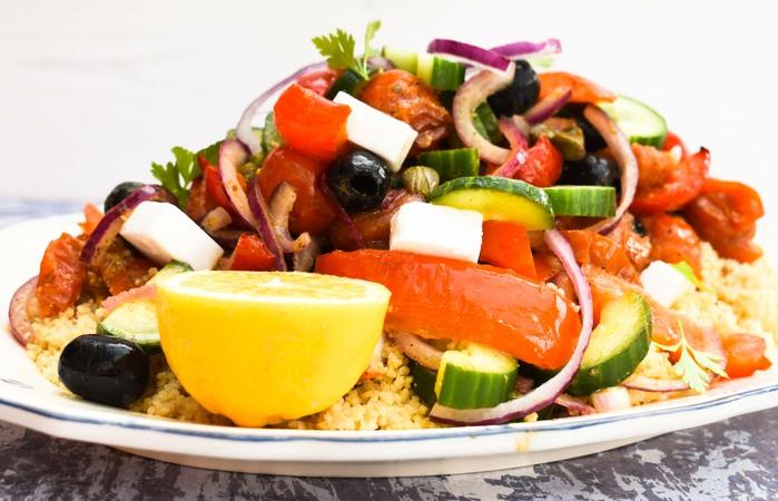 Roasted vegetable Mediterranean couscous salad on a platter