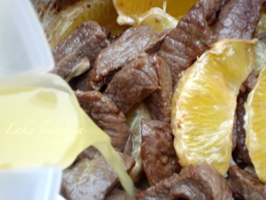 orange juice and orange slices with fried beef chunks