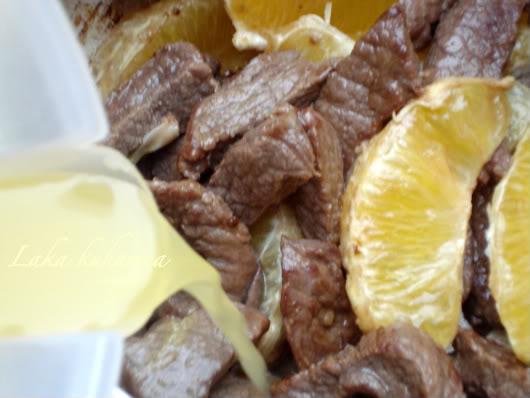 orange juice and orange slices with fried beef chunks