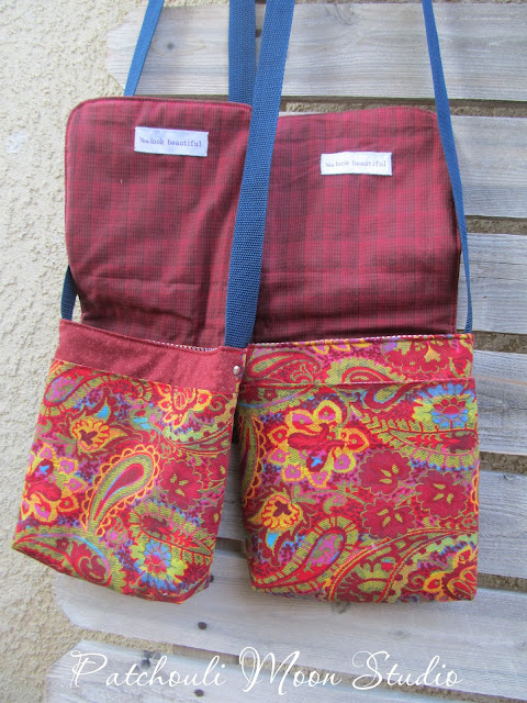 Flaps up to see the lining and front pocket of purses