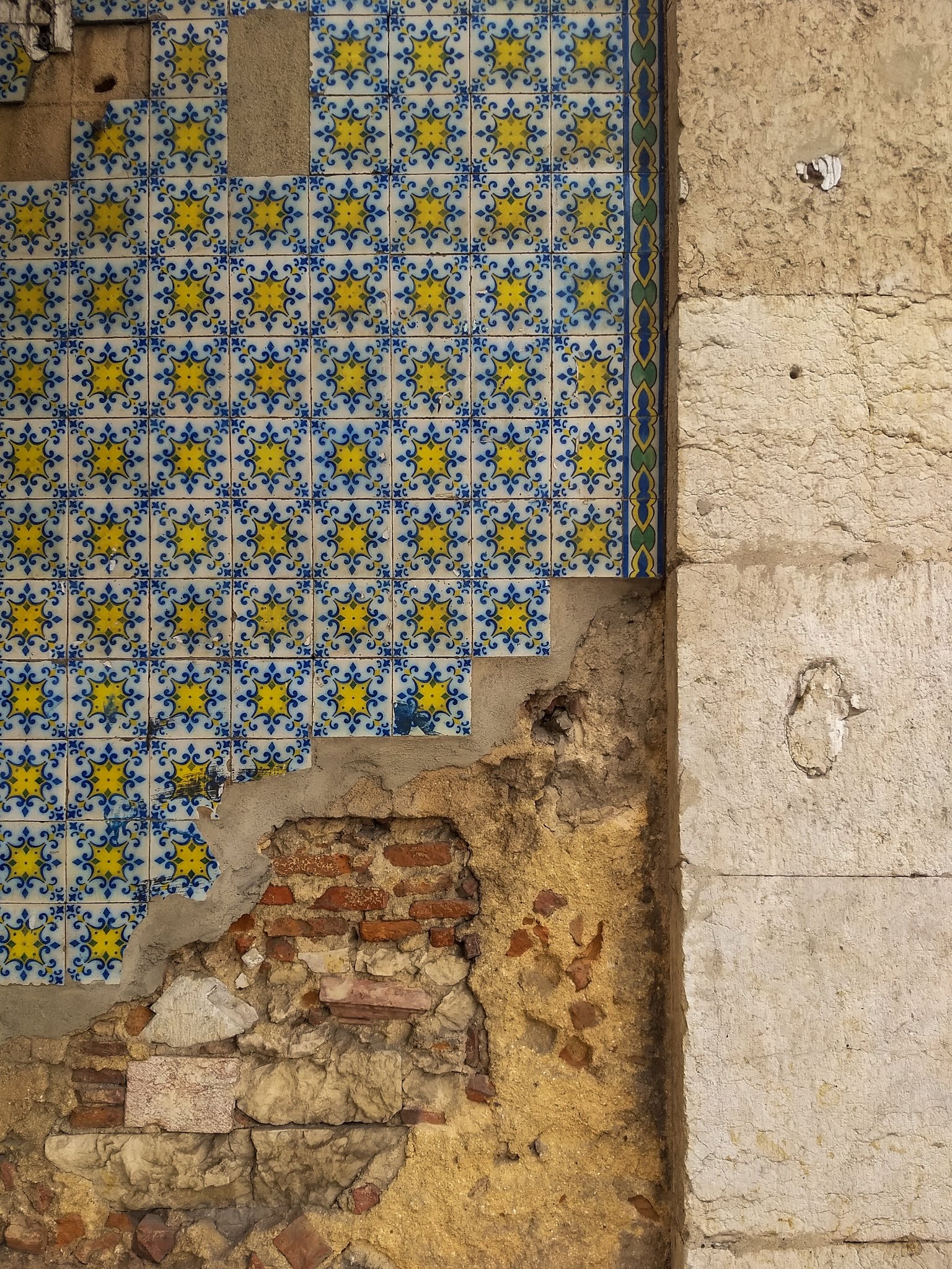 Old, crumbling tiled wall in Lisbon, Portugal.