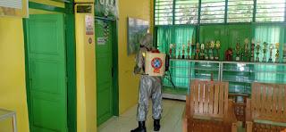 Lawan Covid-19 Satuan Brimob Polda Jambi lakukan Penyemprotan Disinfektan di Beberapa Sekolah yang ada di Kota Jambi