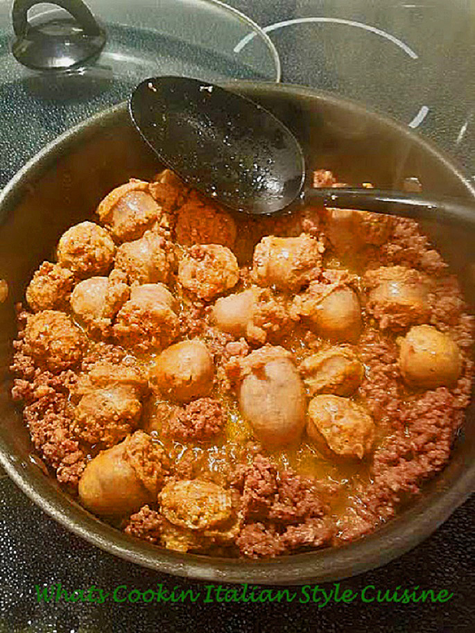 This is a rich Italian sausage sauteed with  garlic, hamburger meat, and spices on a