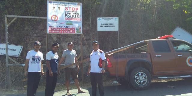 BPBD Boltim Pasang Baliho Himbauan Larangan Buang Rokok Sembarangan