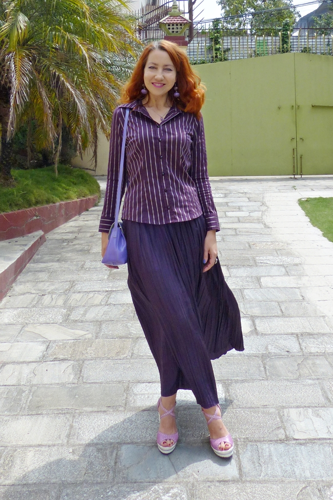 Silk pleated skirt worn with a shirt